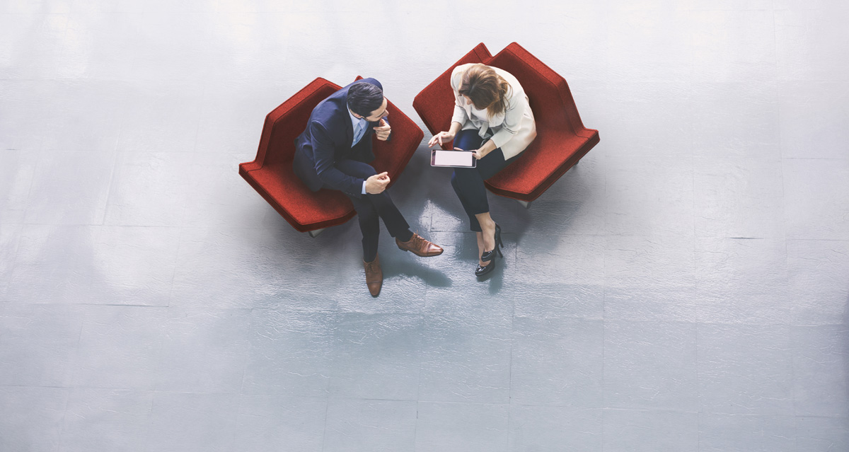 man and a woman in a business meeting